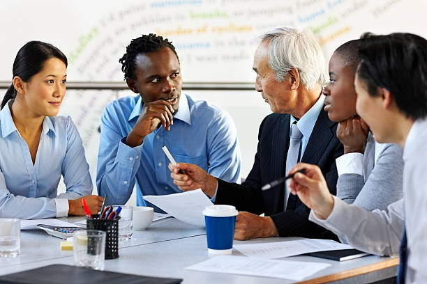 Group of multi racial businesspeople discussing business issues in a meeting